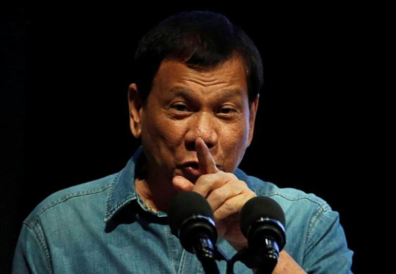 https: img-k.okeinfo.net content 2017 04 06 18 1660573 peringati-hari-kemerdekaan-filipina-duterte-tancapkan-bendera-di-lcs-ZfIpDiUSr3.jpg