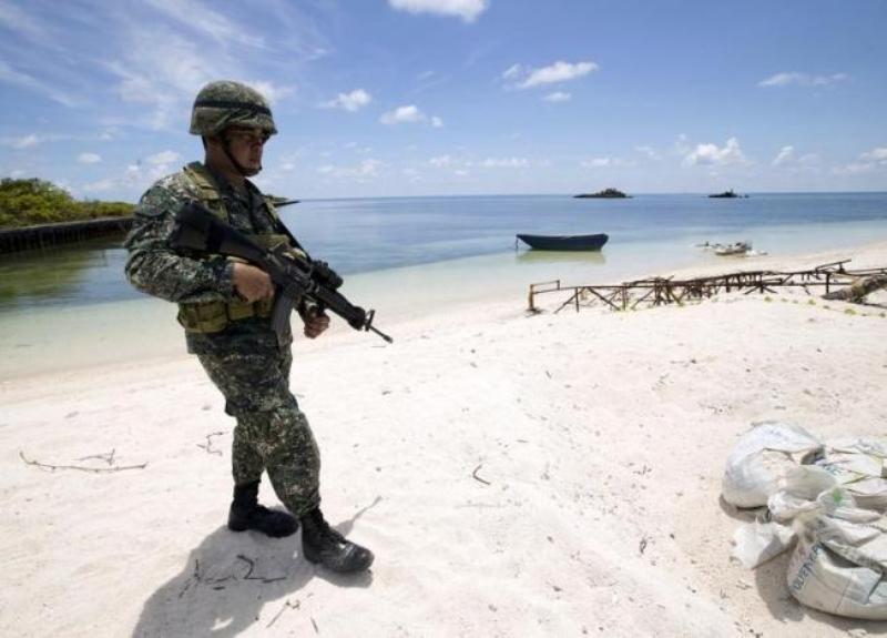https: img-k.okeinfo.net content 2017 04 07 18 1661630 kembangkan-fasilitas-militer-filipina-dituduh-duduki-pulau-baru-di-lcs-ZniMEI3YG0.jpg