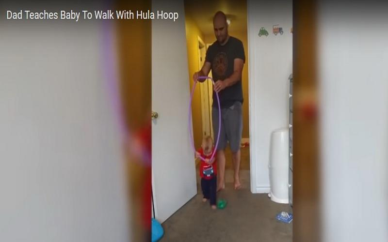 https: img-k.okeinfo.net content 2017 09 13 196 1775038 viral-video-tunjukkan-seorang-ayah-ajarkan-bayinya-berjalan-pakai-hula-hoop-2S3RyLQUmJ.jpg