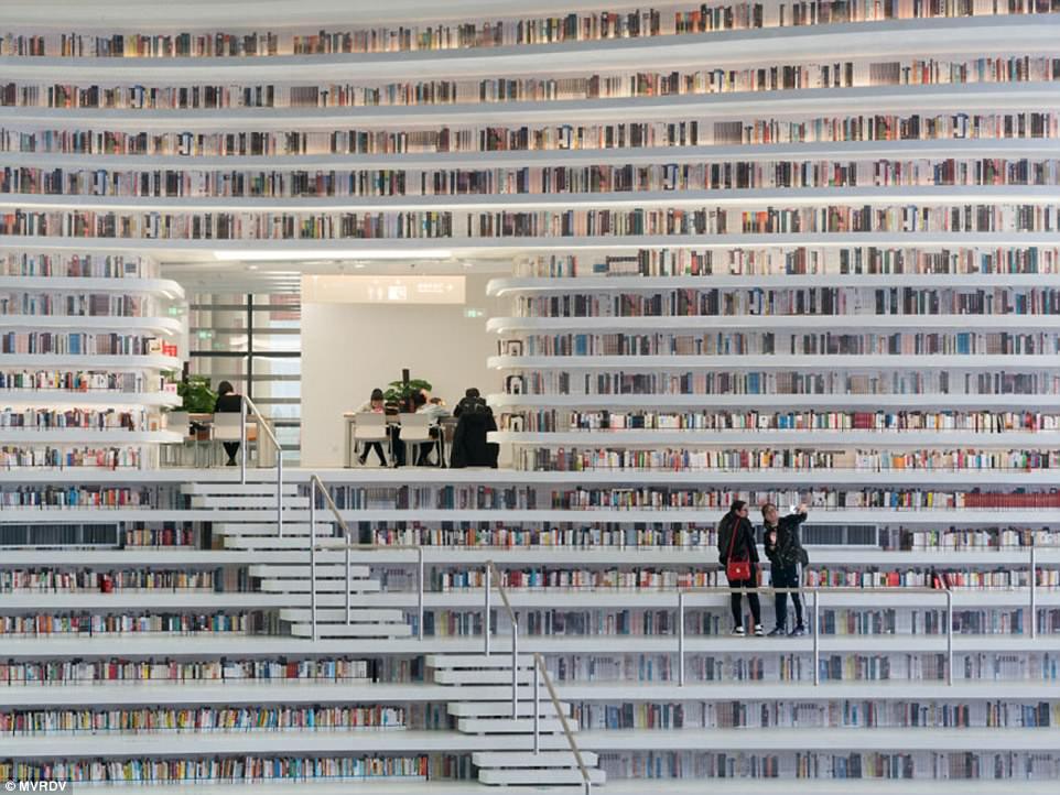 https: img-k.okeinfo.net content 2017 11 14 196 1813823 surganya-pencinta-buku-perpustakaan-kekinian-ini-punya-1-2-juta-judul-buku-yang-siap-manjakan-anda-W7Dr6kWZnJ.jpg