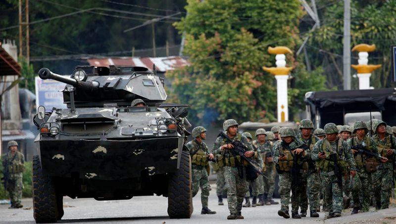 https: img-k.okeinfo.net content 2017 12 31 18 1838028 pasukan-keamanan-filipina-bersihkan-kota-marawi-dari-senjata-dan-bom-tanam-gDyf9Cz506.jpg