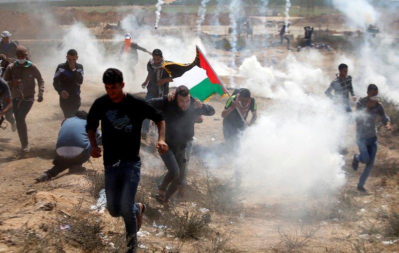 https: img-k.okeinfo.net content 2018 06 09 18 1908630 tentara-israel-bunuh-4-warga-palestina-dan-lukai-600-orang-lainnya-a5gGmwiEyU.jpg