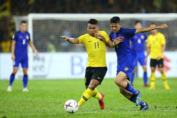 https: img-k.okeinfo.net content 2018 12 01 51 1985609 malaysia-tahan-imbang-thailand-di-leg-i-semifinal-piala-aff-2018-pp83WZgdvS.jpg