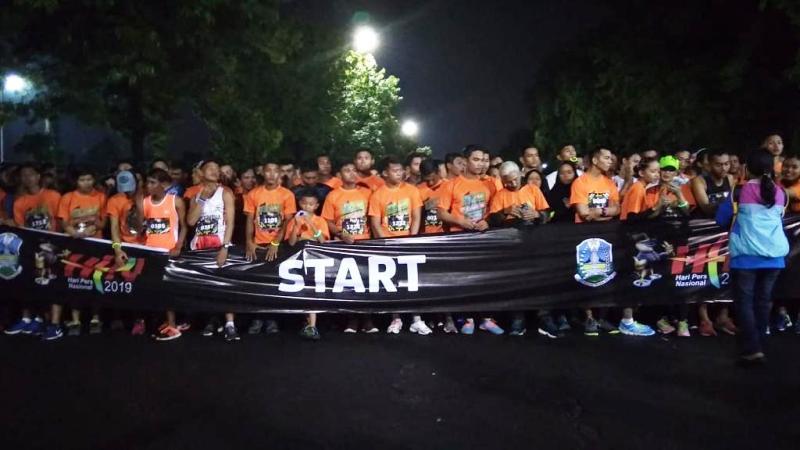 https: img-k.okeinfo.net content 2019 02 03 519 2013131 5-000-peserta-meriahkan-5k-fun-run-hpn-2019-di-surabaya-exMhbi90ez.jpg