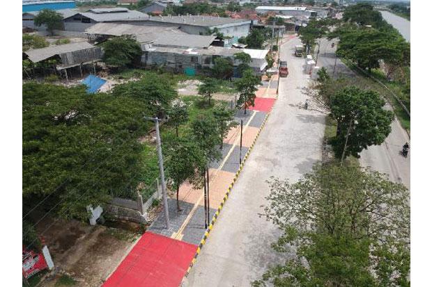 https: img-k.okeinfo.net content 2019 02 22 470 2021394 bekasi-bangun-trotoar-ramah-disabilitas-2v61aAll9L.jpg