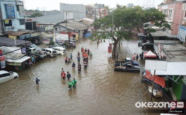 https: img-k.okeinfo.net content 2020 04 01 525 2192193 diguyur-hujan-deras-6-kecamatan-kabupaten-bandung-terendam-banjir-ZUpFDm9Ujo.jpg