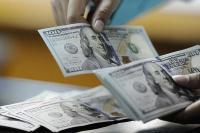 Dolar AS Melemah di Tengah Perundingan Perang Dagang