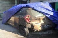 Mobil Taksi Online Terbakar Secara Misterius saat Parkir di Depan Rumah