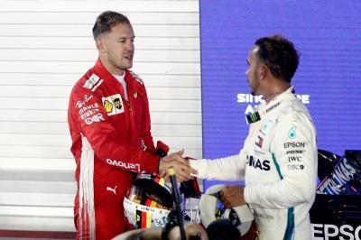 Hamilton Bela Vettel dari Serangan Media