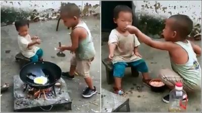 Viral di Medsos, Video Bocah Masak Nasi Goreng Sendiri untuk Adik, Sedih Lihatnya!