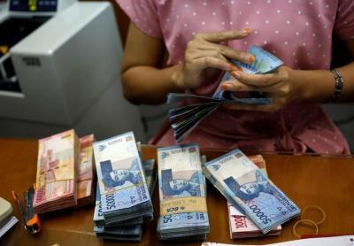 Sambut Akhir Pekan, Rupiah Ditutup Manis di Rp14.037 USD